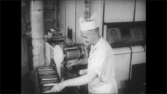 A machine shapes dough in preparation for its baking.