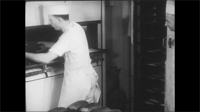 A baker trains an apprentice in the process of baking bread.