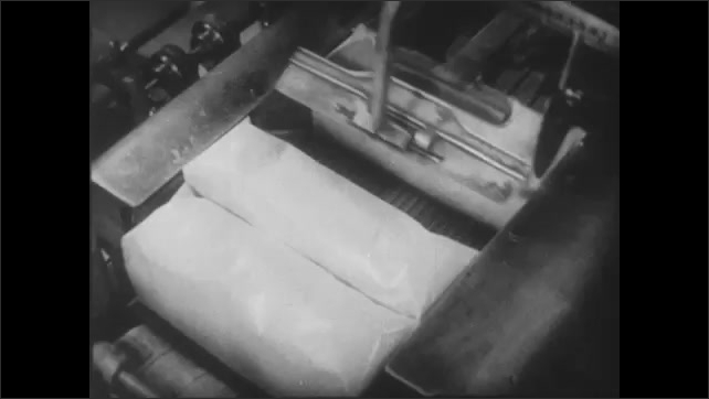 An automatic wrapping machine covers baked bread.