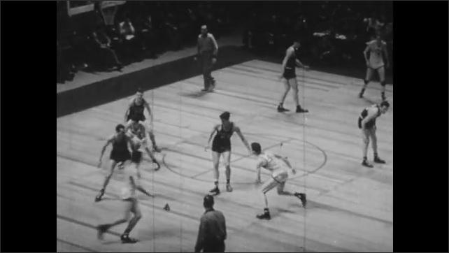 1940s: Men play basketball.
