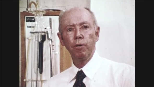1970s: UNITED STATES: man in laboratory speaks to camera. Man in studio speaks to camera