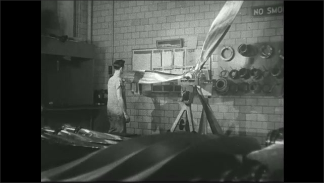 UNITED STATES 1940s  ?????Propellers. Man spins propeller.