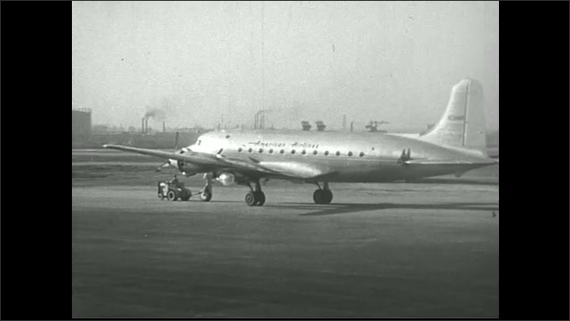 UNITED STATES 1940s  ????? passenger plane taxis on runway.