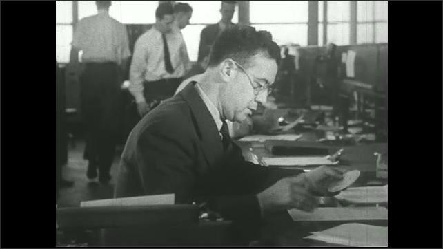 UNITED STATES 1940s  ????? air traffic control room. Man makes phone call.