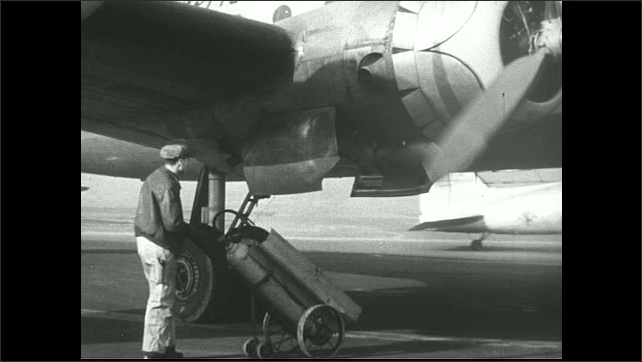 UNITED STATES 1940s ?????Workers prepare  American Airlines plane for departure.