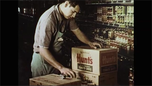 UNITED STATES 1950s: Man puts canned food on shelf / Hand puts price stickers on cans / Man puts cans on shelf / Hands arrange cans.