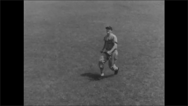 1940s: Terry Moore crouches and in slow motion runs to catch a ball.