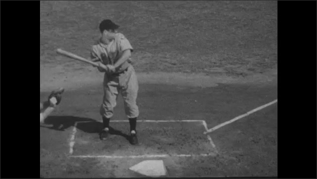 1940s: Players tag up at first and third base as the ball is fielded in the outfield. Batter Morrie Arnovich in the batter box. Batter makes solid contact with the ball and hits it.
