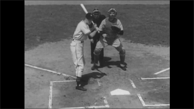 1940s: Player bunts. Player bunts in slow motion and the catcher runs after the ball in slow motion.