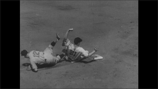 1940s: Player Arky Vaughan. Baseman tags runner out on base but runner slides into base and knocks over the baseman. Baseman misses the catch and the runner slides in safely.