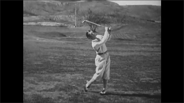 1930s: Golf course.  Man swings golf club and hits ball.  Man steps backward.