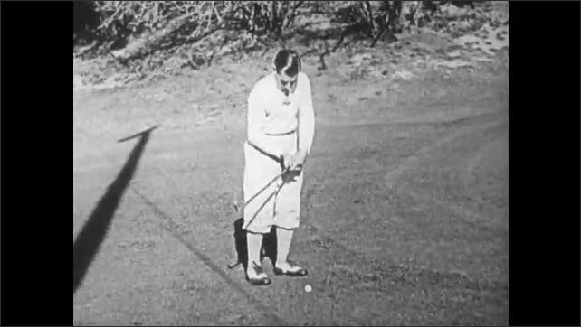 1930s: Text card. Golfer approaches ball on fairway. Golfer strikes ball with iron. Text card.