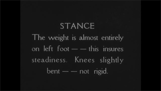 1930s: Intertitle about proper putting stance. Still of golfer putting grip. Intertitle advising the overlapping grip for putting.