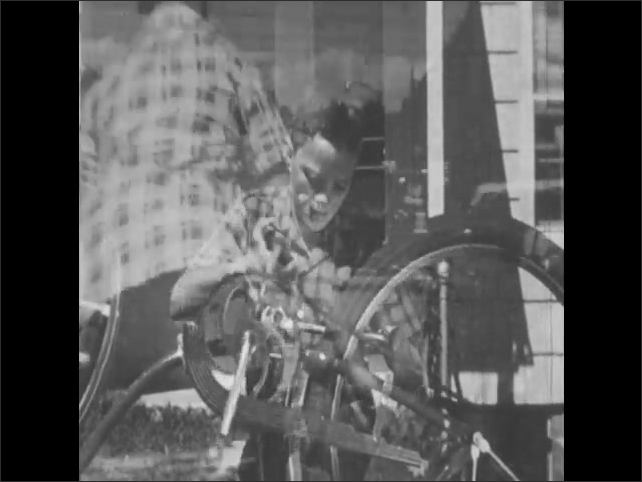 1950s: Boys manually spins bike pedals, turns wheel, tests brakes. Boy rides bicycle with traffic.
