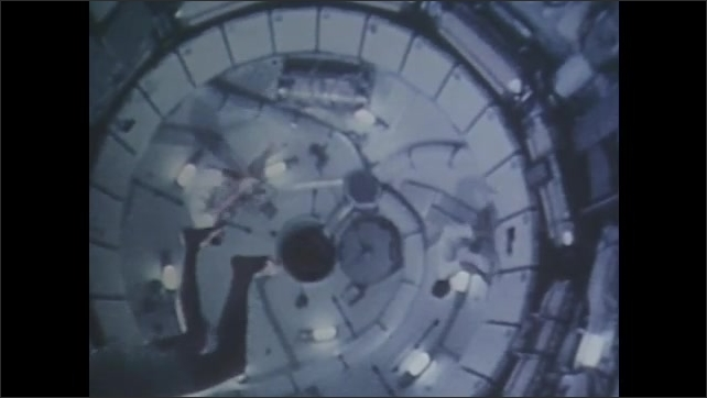 1960s: Lunar module flies over moon????s surface. Three people move in zero gravity simulator. Space rocket takes off. People watch rocket take off from afar. Space rocket flies in the sky.