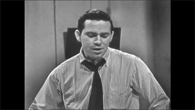 1950's: Man in tie and shirt talks brashly and loudly in Southern accent.