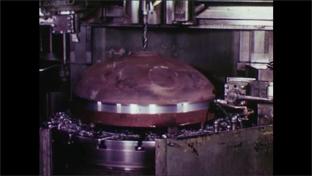 UNITED STATES: 1960s: liquid cools hot metal in factory