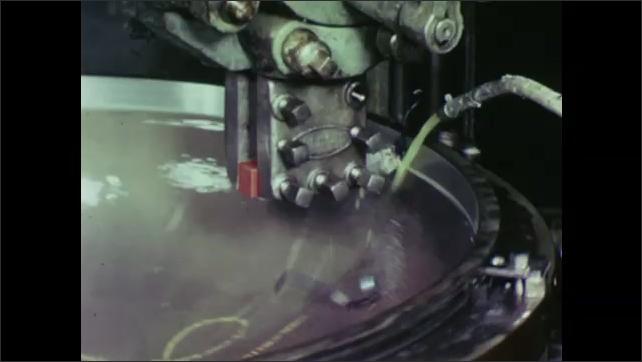 UNITED STATES: 1960s: metal spins on machine.