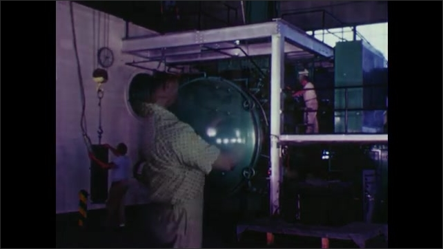 UNITED STATES: 1960s: molten metal inside furnace. Metal pours from container. Man opens door.