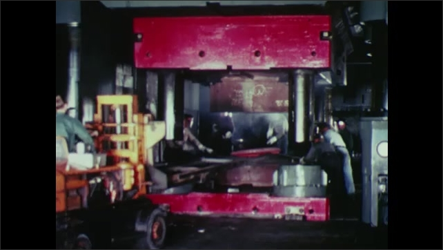 UNITED STATES: 1960s: machine places metal on machine surface.