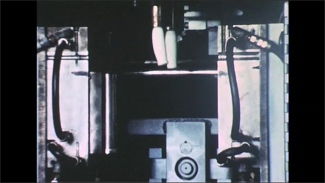 UNITED STATES 1950s: Machine part turns / Arrow on machine part moves / Plastic pours, mold closes / Plastic molding machine, mold opens.