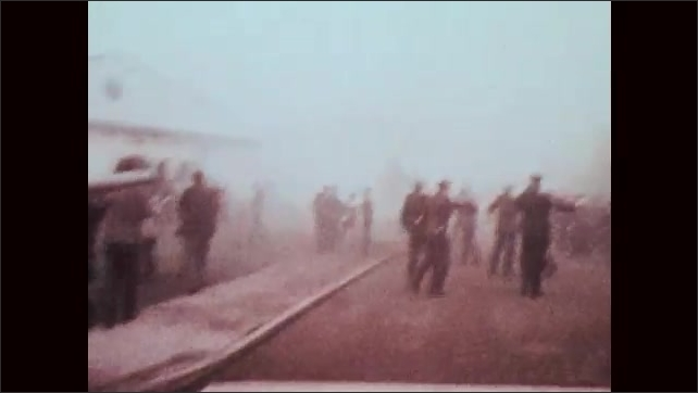 1970s: Police officers line up outside church. Bomb explodes near church. People run and shout.