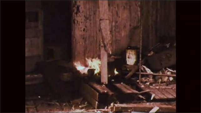 1970s: police officer throws Molotov cocktail at wooden building, porch catches fire