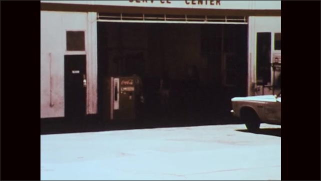 1970s: two couples walking into buildings, man sells canister of fuel to couple