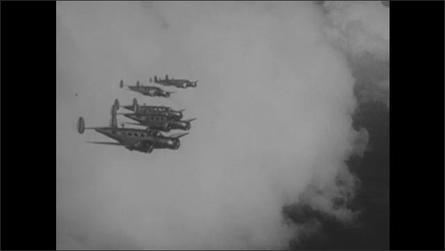 1940s: EUROPE: planes on ground start engines. Propellers on planes. Planes fly in formation in sky