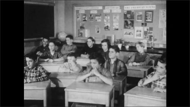 1950s: Students sit in classroom.