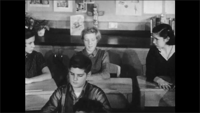 1950s: Students sit in classroom.  Girl speaks.