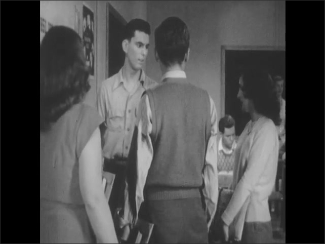 1950s: UNITED STATES: students talk in corridor. Students in classroom