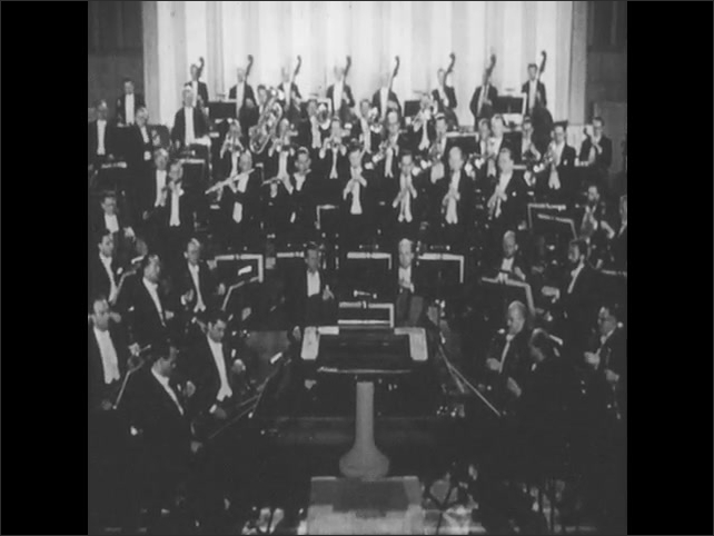 1950s: UNITED STATES: band play military music in concert. Musicians perform in concert