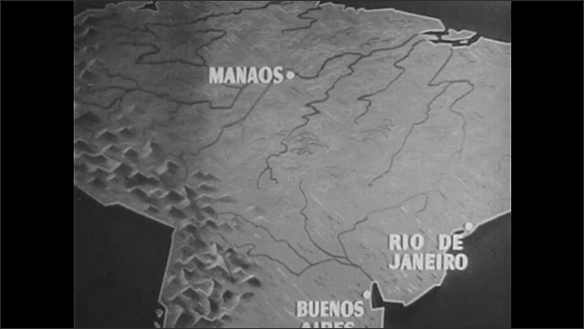 1940s: Animated map of South America, zoom in to city on map. High angle view of rain forest. Zoom in to city on map.