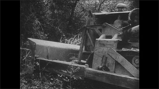 1940s: Man walks through steel mill. Man drives bulldozer into patch of trees. Bulldozer topples trees.