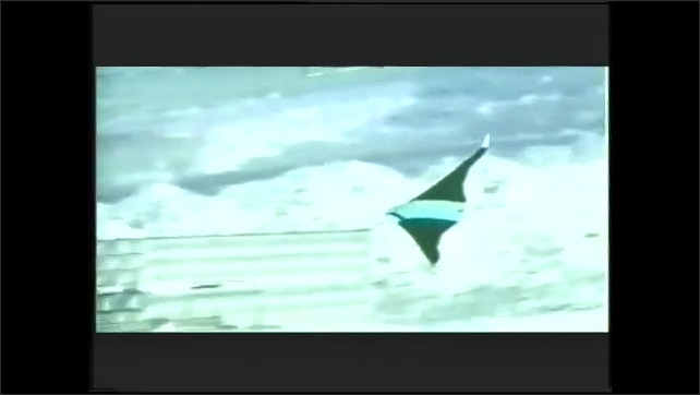 1990s: Man talks. Another man talks. FLIR image of experimental plane in flight. House and car after destroyed by bombing.