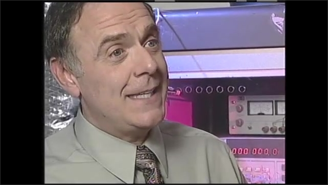 1990s: Space shuttle lands. Astronaut performs repair on space shuttle. Man speaks. Data on computer screen.