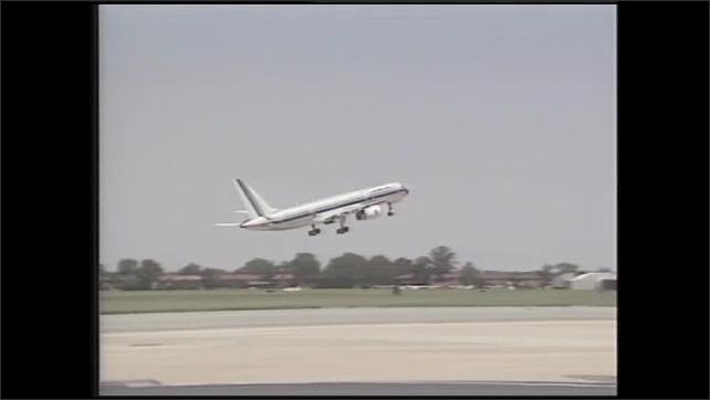 1990s: Plane takes off. Man talks.