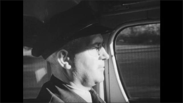 1940s: Vehicle drives over bridge. Factories and industrial buildings below bridge. Bus driver drives bus. Passengers begin to gather belongings.