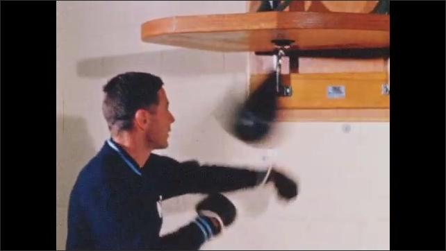 1960s: Men playing handball. Man lifting weights. Man stretching on mats. Man boxing punching bag. Man jumping on trampoline. Man pulls down weight. Men climbing ropes.