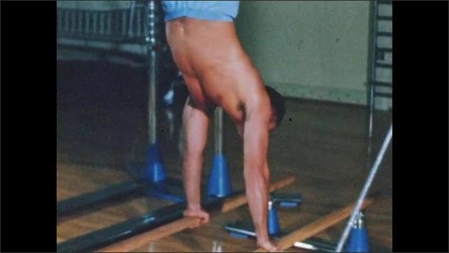 1960s: Feet pedaling stationary bike. Man jumping on trampoline. Man boxing. Man on parallel bars. Man jumping rope. Feet jumping. Man wipes brow.