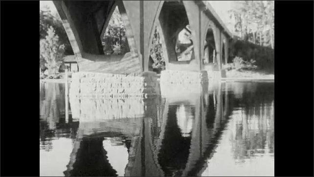 1950s: Trees, lake, village. Bridge.