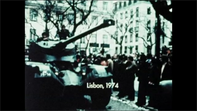 1970s: AFRICA: Vote for Stability banner. Man speaks to members at National Party. Lisbon, Portugal protests.