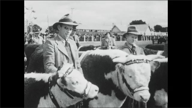 1940s Australia: Little girls smile.  Men stand with steers.  Windmills.  Fairgrounds.  Cars.