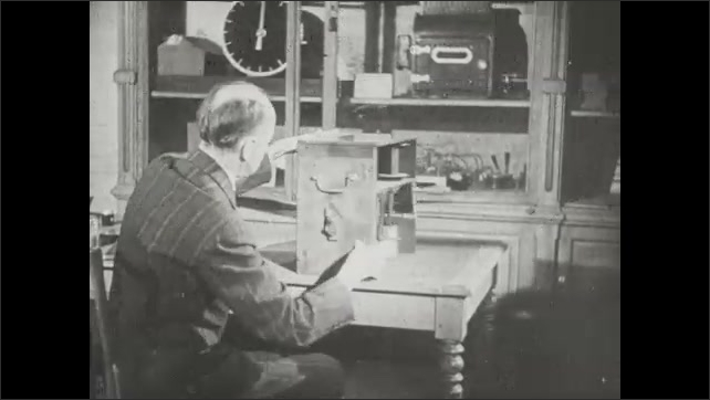 1940s: Chronophotograph camera loaded with negative film strip and cranked through the camera on a studio bench.