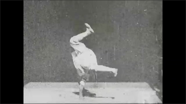1940s: Kinetoscope of acrobat doing handsprings and backflips. Man with staff does maneuvers and poses in kinetoscope.
