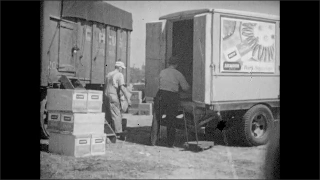 1940s: UNITED STATES: circus people test fire equipment. Local fire brigade support circus fire crew. Man unloads food for circus workers.