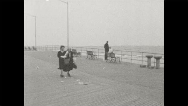 1940s: People walk around on boardwalk.