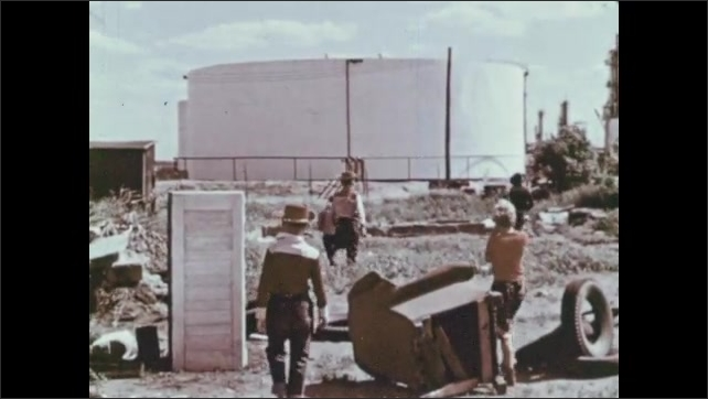 1970s: UNITED STATES: boys look for friend. Boy opens cupboard door.
