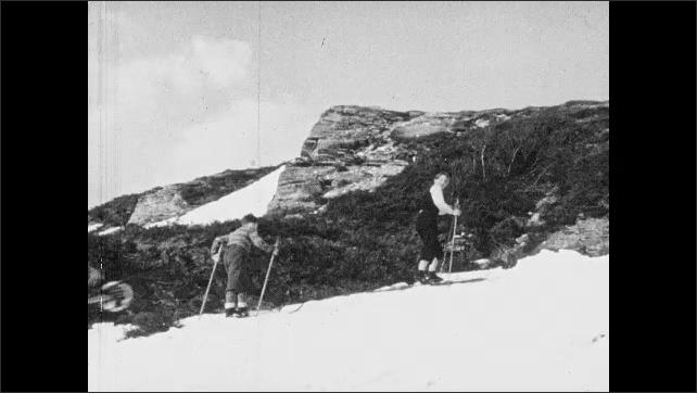 1950s: Pile of lumber.  Mountain.  Sea.  Kids ski down hill.